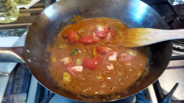 The tomatoes have been added to the pan