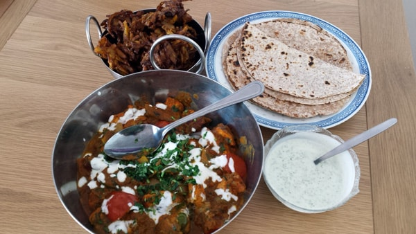 The Balti meal, complete with dishes containing onion bhajis, chapatis and mint sauce, ready to serve